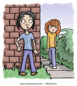 stock-photo-angry-girl-approaches-a-worried-girl-hiding-behind-a-wall-490312441