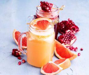 70275306-pomegranate-and-citrus-fresh-juice-slice-of-fresh-fruit-300x255