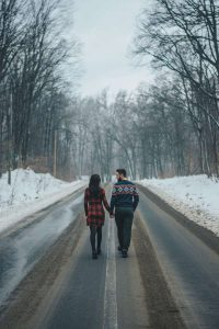 photo-of-couple-walking-on-road-near-bare-trees-2536587