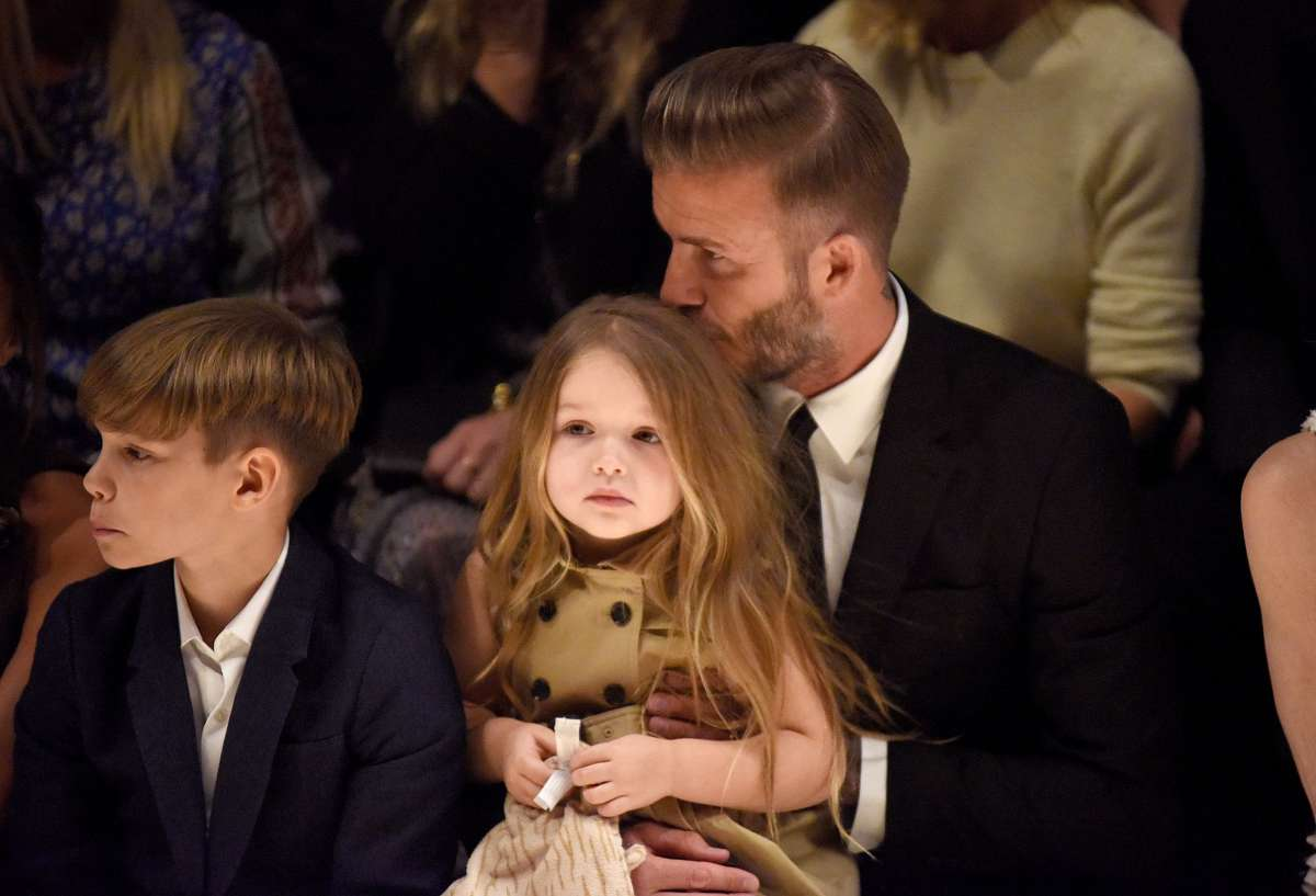 resized_David, Romeo and Harper Beckham on the front row at the Burberry _London In Los Angeles_ event.