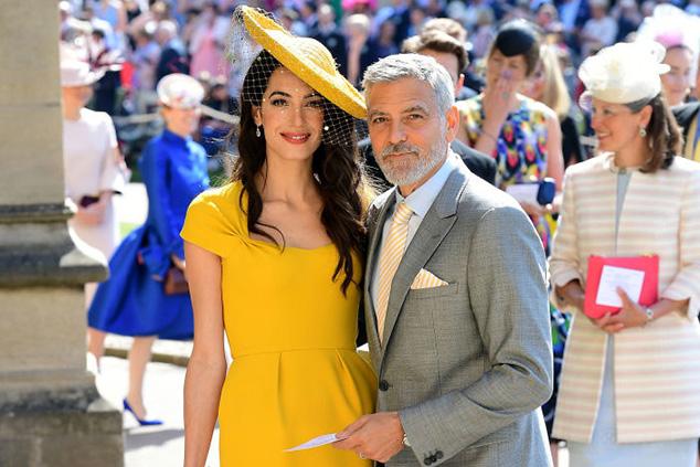 ג'ורג' ואמל קלוני בחתונה של מייגן והארי (Ian West - WPA Pool/Getty Images)