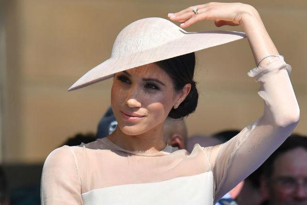 מייגן והכובע צילום: Photo by Dominic Lipinski - Pool/Getty Images
