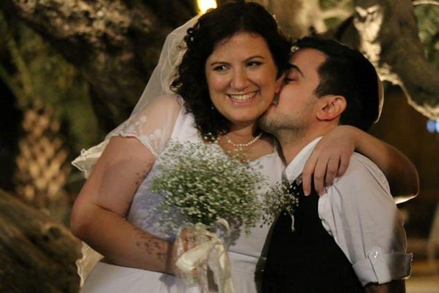 בן לאון עם אשתו אסנת בחתונתם (צילום: גיא חמוי)