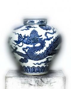 Porcelain jar painted with a cobalt blue dragon under a transparent glaze, early 15th Century.